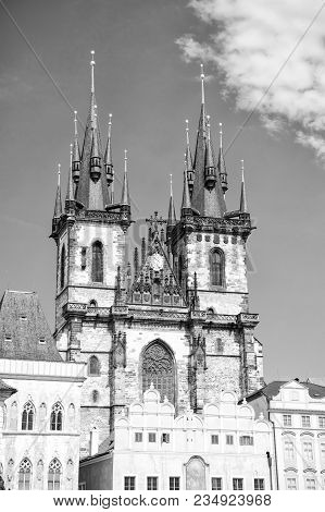Church With Spire Towers In Prague, Czech Republic, On Sunny Blue Sky Background. Religion, Architec