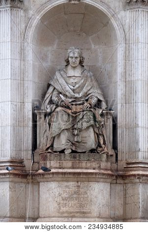 PARIS, FRANCE - JANUARY 04: Fenelon by Francois Lanno. Fountain of the Sacred Orators, Place Saint-Sulpice in Paris, France on January 04, 2018.