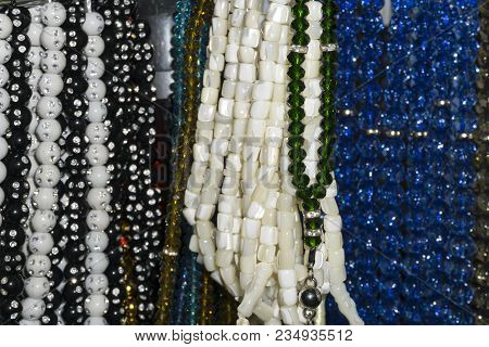 Colorful Glass Beads And Rosary Beads On The Souvenir Shop Shelf