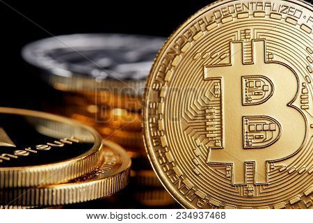 Digital Cryptocurrencys Bitcoin, Ethereum And Litecoin On The Wooden Background. Cryptocurrency Conc