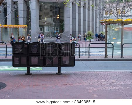 San Francisco, Ca - March 30, 2018: Empty Newsstand Machine In Downtown San Francisco. This Reflects