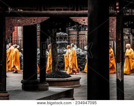 Chengdu, China - August 27, 2012: Buddhist Monks In Orange Robes Walks Between Columns Of Wenshu Mon