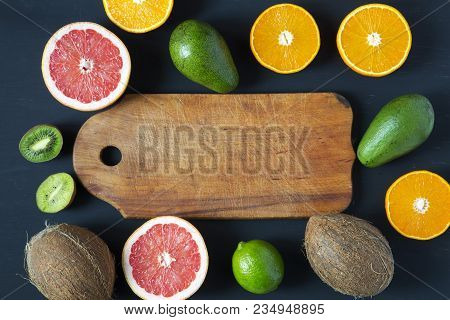 Flat Lay. Top View. Wooden Board With Sliced Colorful  Fresh Fruits: Kiwi, Orange, Grapefruit And Ma