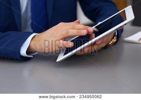 Businessman Using Touchpad At Meeting, Closeup Of Hands.