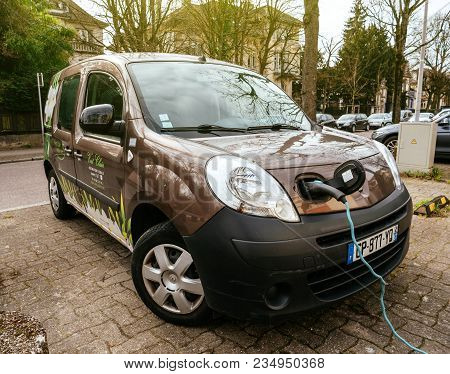 Strasbourg, France - Circa 2018: Modern Technology - Plugged In Renault Mini-van Electric Car On The