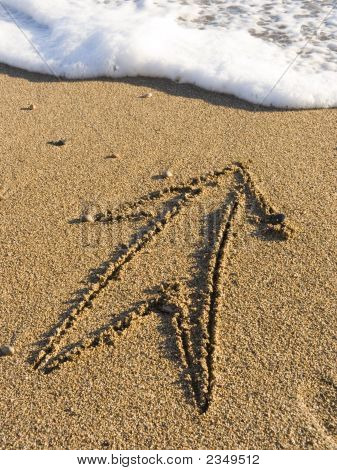 Arrow On Wet Sea Sand