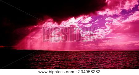 A Spectacular Hot Pink Sunbeams Sunrise Over Tropical Water With Brightly Colored Crepuscular Rays A