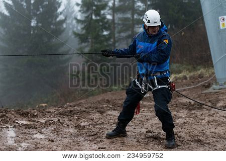 Rescue Man Helping Out On Land With Rope