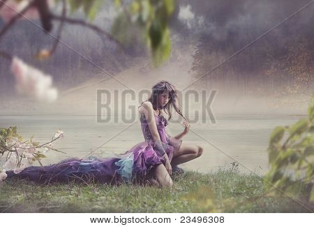 Beauty woman in fairy scenery