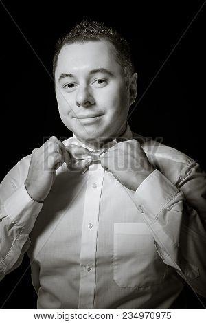 A Man Corrects A Necktie Close Up