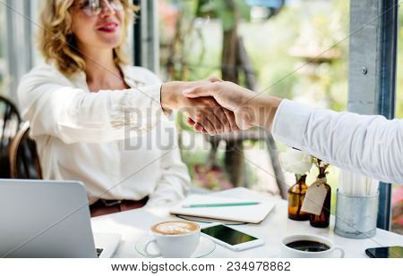 Business people is shaking hands