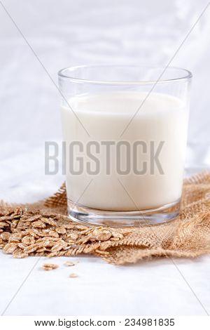 Single Glass Of Oats Milk. Plant Milk.