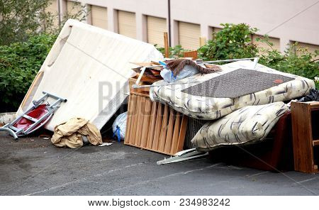 Tenants Who Were Evicted Left Their Broken Furniture On The Pavement Outdoors.