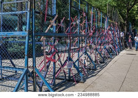Wooden Crosses In Pink As A Protest Against Insecurity And Feminicide In Mexico, Placed On Reforma A
