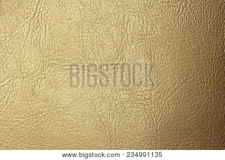 Gold Gradient Background. Gold Or Bronze Natural Leather Background. Shiny Yellow Leaf Gold Foil Tex