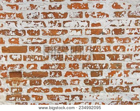 Old Wall Of Red Bricks And White Brayed And Cracked Old Paint. Red, Terracotta And White Brick Backg