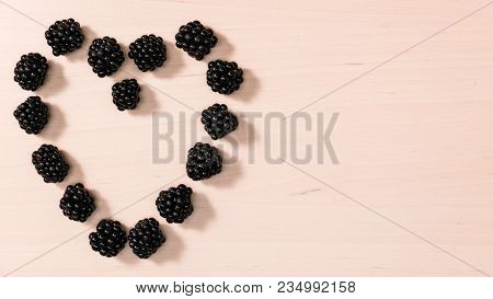 Fresh Berries Of Blackberry Fruits Blackberries In Form Shape Heart On Wooden Table Background. Conc