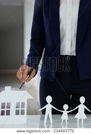Cut outs of house and family with model in hall