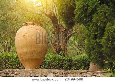 Large Ceramic Terracotta Pot In The Park. Botanical Garden Of Taormina. The Island Of Sicily, Italy.