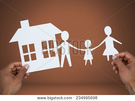 Cut outs of house and family in hands