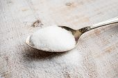 Artificial Sweeteners and Sugar Substitutes in metal spoon. Natural and synthetic sugarfree food additive:  sorbitol, fructose, honey, Sucralose, Aspartame poster