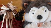 Close-up of a stuffed animal as part of a larger Christmas display. poster
