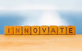 Image Of Inscription Of Innovation On Blurred Background