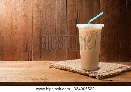 Ice Milk Coffee And Coffee Bean On Empty Wooden Copy Space In Still Life Style