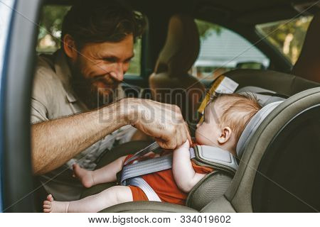 Father Putting Baby In Safety Car Seat Dad And Child Together Family Road Trip Vacations Lifestyle I