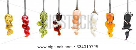Sauces Assortment. Set Of Various Sauces On Spoons. Popular Sauces Isolated On White, Top View, Copy