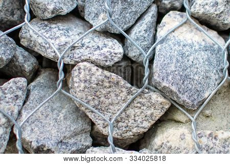 Stone Gabion Wall. Gabion - Stones In Wire Mesh. Popular Element Of Design For Garden Landscaping An