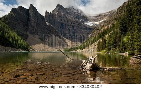 Panoramic Image Of Lake Agnes, A Quiet Place Surrounded By The Rocky Mountains Close To Lake Louise,