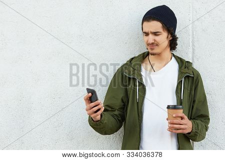 Unsatisfied Disappointed Youngster Standing Outdoors, Spending Time Alone, Checking Social Networks,