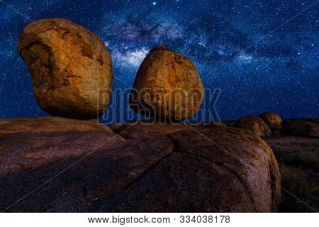 Scenic Nocturnal Australian Outback Landscape Of Devils Marbles The Eggs By Night With Milky Way, St