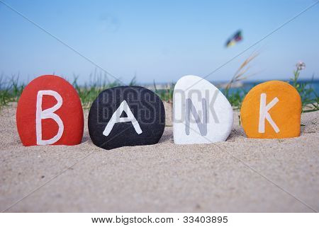 Bank concept over colourful stones