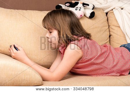 Teen Girl Looking To The Her Smartphone.