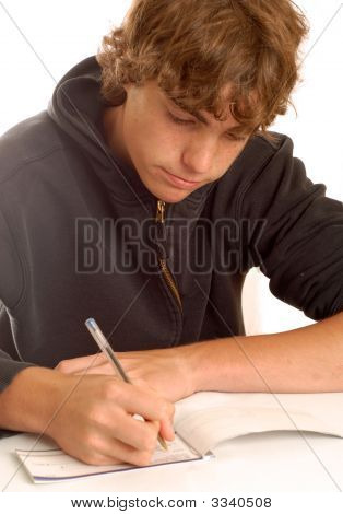 Teenage Boy Writing A Check