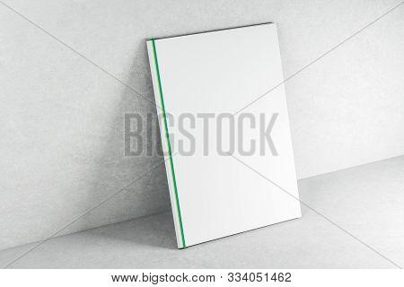 Empty White Book On Concrete Backdrop