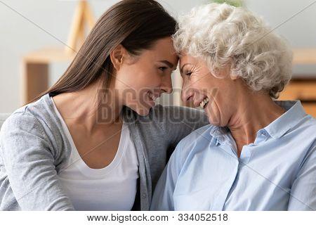 Smiling Two Generation Women Family Laughing Bonding Cuddling Together