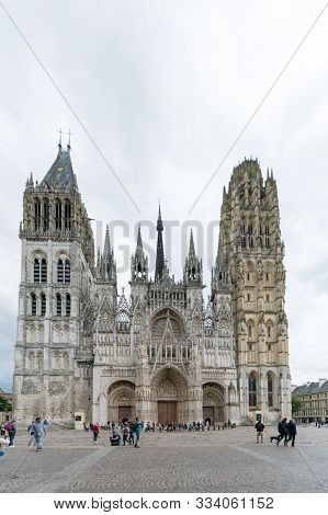 Tourists Enjoy A Visit To Rouen And The Historic Cathedral