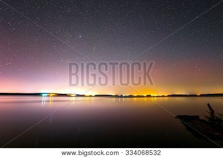Starry Sky Background Picture Of Stars In The Night Sky And The Milky Way. Starry Sky Over The Lake.