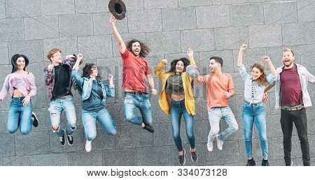 Group Of Young People Jumping Together Outdoor - Happy Millennial Friends Celebrating Success In Col