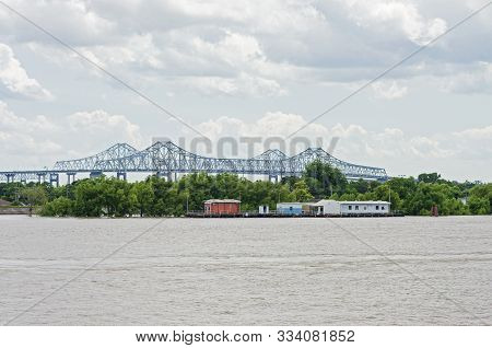 Pier At Algiers Point And Crescent City Connection Bridge Along Mississippi River In New Orleans Lou