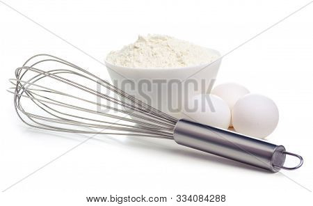 White Bowl With Flour And Eggs, Whisk On White Background Isolation