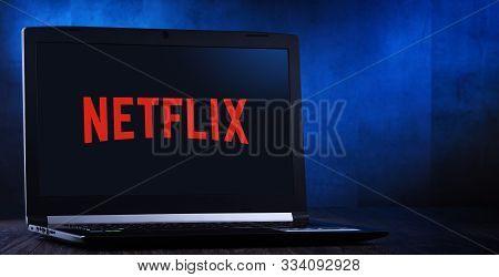 Poznan, Pol - Nov 14, 2019: Laptop Computer Displaying Logo Of Netflix, An American Media-services P