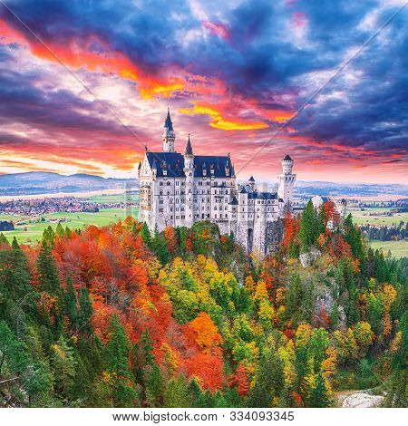 Majestic Sunset View Of Famous Neuschwanstein Castle In Autumn.  Location: Village Of Hohenschwangau