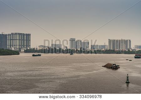 Ho Chi Minh City Vietnam - March 12, 2019: Brown Song Sai Gon River With Some Smaller Boats. Green B