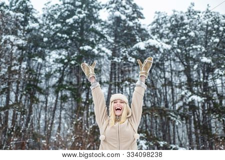 Winter Girl. Happy Woman. Winter Forest Happy Mood. Happy Girl Raised Her Hands Up. Christmas Time.