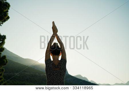 Young Woman Making Yoga Asana Outside