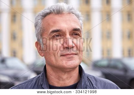 A Successful Well-groomed Man Over 50 Years, Short Gray Hair, A Pleased Look, Casual Clothes, The Fa